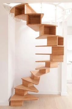 What's better than a spiral staircase? A spiral staircase you can put Knick-knacks in! Rustic Staircase, Small Staircase, Loft Staircase, Basement Stairs, Modern Staircase, House Stairs, Staircase Design, Spiral Staircases, Staircase Ideas