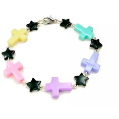 Pastel Goth Cross Bracelet Black Star Multicolored Light Colored Fairy... (355 UYU) ❤ liked on Polyvore featuring jewelry, bracelets, accessories, pastel, star charms, lobster clasp charms, star charm bracelet, circle bracelet and cross bracelet