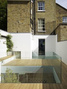 A basement extension and courtyard designed with glass walls