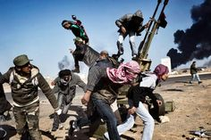 March 11, 2011. Rebels flee under fire from the Libyan army in Ras Lanuf.
