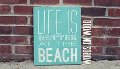 "Wooden Sign that saying ""Life is Better at the Beach"". A perfect Wooden Sign for that place you call home, or home away from home. Great beach house decor. Choose your color and size to make it perfect for your space :: WordsOnWood.com"