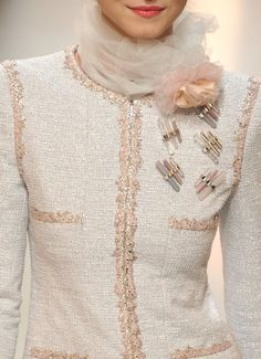 Chanel Couture    This shade of pale blush and the sheer scarf and those pins , not one pin but 5.... perfect
