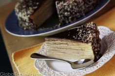 This is my favorite cake. All 21 layers of it. It has been since my mitten-wearing years. My mom used this intricately layered almond and chocolate cake as an activity for us kids - something to ke...