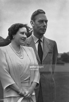 King George VI and H. Queen Elizabeth, (later Queen Elizabeth, the Queen Mother) in the grounds of Windsor Castle,