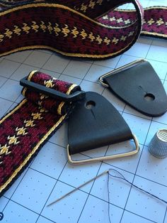 Houzz Makers Show Us Their Favorite Tools and Materials- Cheryl Taylor of Lake of the Pines, CA is featured in this article for her clever use of porcelain insulators as weights for her card weaving. Guitar strap in the works using leather tabs from ASpinnerWeaver on Etsy.
