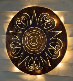 Lighted Sunburst Recycled Oil Drum Lid Wall Art - it's a circle of light that will bring life to your home day and night. Use indoors or out.