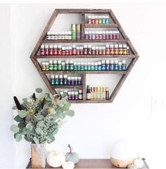 """This handmade wooden hexagon shelf is a fun and unique way to store your essential oils & other home decor! It can fit 3 rows of 15ml bottles or 4 rows of 5ml bottles. Approximately 228 15ml bottles or 376 5ml bottles. :) Dimensions: 27 x 23 1/2"""" x 3 1/2 Our current processing"""