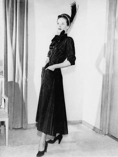"""a """"New Look"""" dress by Christian Dior in 1947..."""