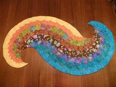 Spicy spiral table runner (link for pattern: http://www.creativequiltkits.com/spicy-spiral-bargello-table-runner-by-school-house-quilts.html)