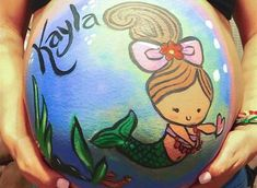 Need some inspiration for a pregnant belly painting session? Scroll through these photos of beautiful baby bumps transformed into pure works of art. Pregnancy Gender Reveal, Pregnancy Photos, Baby Photos, Coral Baby Showers, Bump Painting, Pregnant Belly Painting, Traditional Japanese Tattoos, Baby Shower Princess, Maternity Pictures