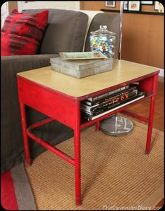 vintage school desk used as a side table - very cool