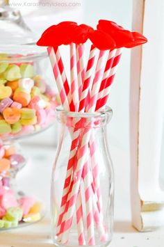 Hot lips on skewers and paper straws. Valentine's party kissing booth via Kara's Party Ideas karaspartyideas.com