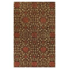 Hand-tufted wool rug with scrolling vine motif.   Product: RugConstruction Material: 100% WoolColor: C...