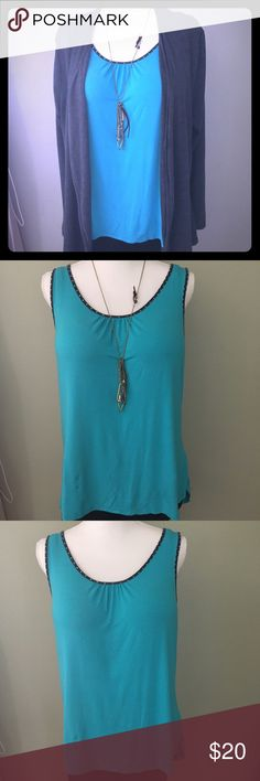 The Limited Blue Knit Tank This azure blue tank is perfect for the office. Pair it with denim or a Cardigan for the perfect weekend outfit as well. The polka-dot edge info makes this shirt fun. Size: XL The Limited Tops Tank Tops