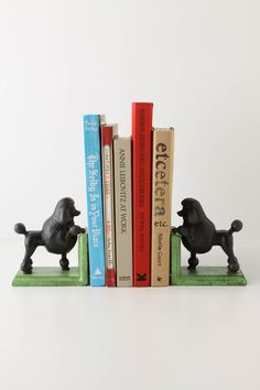 Gomez the Poodle Bookends  from Anthro. {If you're gonna have bookends, make it fun. I could definately handle some Gomez's hangin' out with my books!}