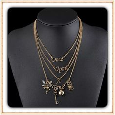 Once Upon A Time Gold Necklace NEW IN PACKAGE  Lovely gold plated layered charm necklace. New in package ⭐️ Jewelry Necklaces