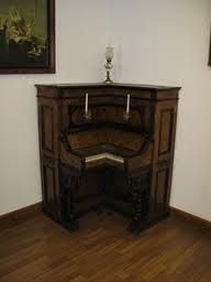 A corner piano in the piano museum. Gulanu Island -- That is so cool. I wonder what it sounds like?