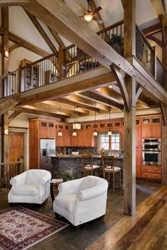 The open floor plan complements the high ceilings in this timber frame kitchen.