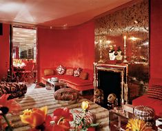 The hall and living-room walls were covered in coral velvet. Rybar had the stainless-steel fireplace, ceiling molding, doorframe, tables, ottomans, and floor custom-made. The silver-gray mink rug is by Oscar de la Renta.