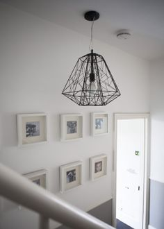 Adina combines her statement Hive Pendant in Black with simple white walls. | made.com/unboxed