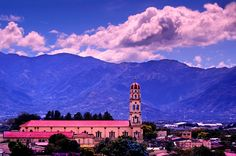 The red dome of the Cathedral of Alajuela rises above the town of Alajuela, Costa Rica.