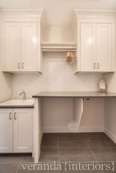 Neutral laundry room - the backsplash tile shape is reminiscent of bubbles...which is perfect for the suds that are created in a laundry room