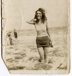 I don't know who she is, but I love this photo. Looks like someone carried around in a wallet for a long time.