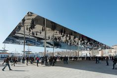 Norman Foster's Simple Mirrored Pavilion Reflects The Crowds Below. Norman Foster's firm erected a thousand-square-meter slab of reflective stainless steel in Marseille. Because two great views are better than one. A As Architecture, Innovative Architecture, Architecture Wallpaper, Temporary Architecture, Norman Foster, The Fosters, Architectural Digest, Architectural Sketches, Architectural Photography