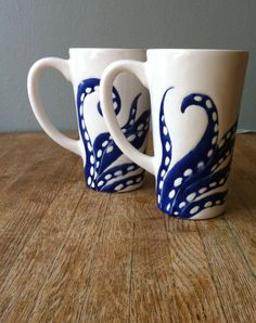 Navy blue octopus legs tall ceramic coffee mugs by jessicahoward, $62.00 - Holy smokes! $62!? I can make those. ;)