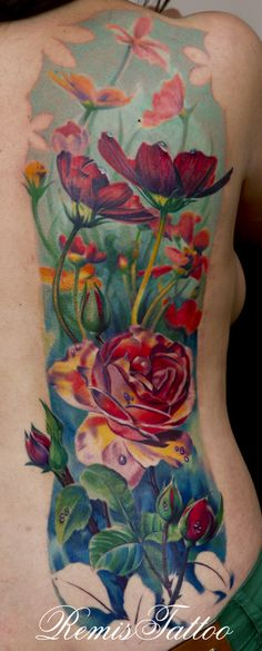 WOW...Love everything about it...placement, subject, style, quality! Too bad this guy lives in Ireland!  realistic color tattoo of flowers by =Remistattoo