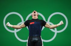 Serghei Cechir of Moldova celebrates during the Men's 69 kg Group B Weightlifting contest on Day 4