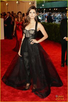 nina dobrev met ball 2013 05, Nina Dobrev takes over the red carpet at the 2013 Met Gala held at the Metropolitan Museum of Art on Monday (May 6) in New York City.    The 24-year-old Vampire…