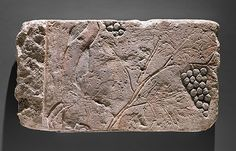 Grapevine, New Kingdom, Amarna Period, Dynasty 18, reign of Akhenaten, ca. 1353–1336 B.C. Egyptian; from Egypt, Middle Egypt, el-Amarna probably; Hermopolis possibly Limestone, paint H. 9 1/16 in. (23 cm), W. 16 9/16 in. (42 cm) Gift of Norbert Schimmel, 1985 (1985.328.23) MET Museum