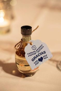tequila favor at each place setting for fiesta wedding