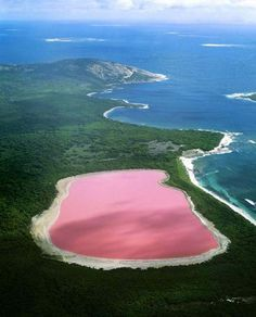 Lake Hillier - From above the lake appears a solid bubble gum pink. No-one fully knows why the lake is pink. Scientists speculate that the colour comes from a dye created by bacteria that lives in the salt crusts.  Check out some other mind-blowing places that really exist ->
