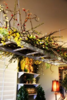I want a hanging ladder like this above my dining room table to decorate with the seasons!  -Savvy Season by Liz - she is brilliant!