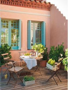 Bistro chairs and round table on deck, shutters on windows, what a nice spot to dine.