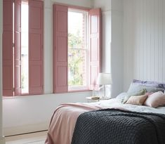 In need of some ideas for colourful bedrooms? Window dressing like solid shutters are a great way to inject personality and character into a bedroom. We love our boudoir pink solid shutters on this neutral soft bedroom colour scheme. Simply perfect!