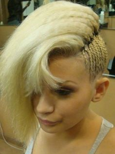 This side-braided style has us thinking about alternatives for our own summer look. Secure cornrows with small elastics, then leave lengths out for an edgy style.