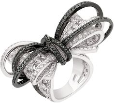 The Chanel Ruban Couture ring in white gold with black and white diamonds - For T's bow collection??