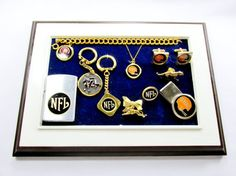 NFL And Bengals Mounted Collection  This is a nice collection of football jewelry mounted and ready for display. The collection features NFL