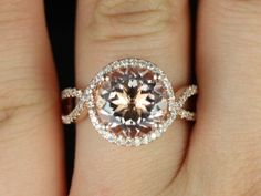 Kendra14kt Rose Gold Round Morganite Halo Twist Engagement Ring (Other Metals and Stone Options Available). $2,250.00, via Etsy.