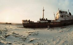 Desert wrecks: The desolate ship cemetery where camels walk beside rusting vessels buried in sand Abandoned Ships, Abandoned Places, Places Around The World, Around The Worlds, Nasa Images, Dust Storm, Tree Tops, Central Asia, Kazakhstan