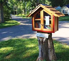I spotted my first Little Free Library at the Omni Starbucks in Richmond, Virginia almost two years ago. I noticed it—I even instagrammed it—but I didn't really know what I was looking at.   a Little Free Library carved into a tree in Hampton, NH (photo) Thefirst Little Free Library—though