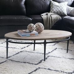 Tables - Cast Base Coffee Table | west elm - cast iron based coffee table, modern industrial coffee table, oval wood topped coffee table, iron based coffee table with wood top,