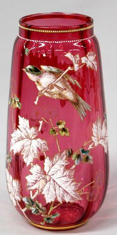 Moser Cranberry Enamel Decorated Vase, c. 1880 Large Moser cranberry optical glass vase with handpainted polychrome enamel and gilt decoration depictinga bird perched on flowering branches. Art Of Glass, Cut Glass, Glass Bottles, Glass Vase, Objets Antiques, Vase Cristal, Glas Art, Cranberry Glass, Flower Branch