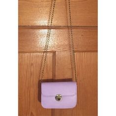 """NWT purple mini crossbody Super cute! Not sure I'm ready to part with this one yet!  Synthetic leather Antique hardware Push lock fastening Flap closure Antique chain strap Fabric lining   Height 4.3"""" / 11cm Width 5.9"""" / 15cm Depth 1.9"""" / 5cm Boutique Bags Crossbody Bags"""