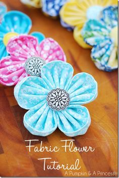 Fabric-Flower-Tutorial - wonder if I could work it out without the gadget they use