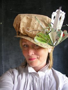 A soft kraft paper short brimmed high crowned beauty. Making best use of an advertising mailer, packing children's primer, and printed cardboard from game thingy. Shot by Paul Clancy hat day Paper Shoes, Paper Clothes, Clothes Crafts, Crazy Hat Day, Crazy Hats, Recycler Diy, Funny Hats, Newspaper Crafts, Diy Hat