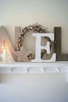 Inexpensive Ways Of Decorating Your Home For The Holiday Season NOEL letters made from rustic wood plus a simple wreath. Love this presentation.NOEL letters made from rustic wood plus a simple wreath. Love this presentation. Merry Little Christmas, Noel Christmas, Christmas Is Coming, Winter Christmas, Christmas Letters, Christmas Scrapbook, Christmas Fireplace, Christmas Lights, Christmas Design